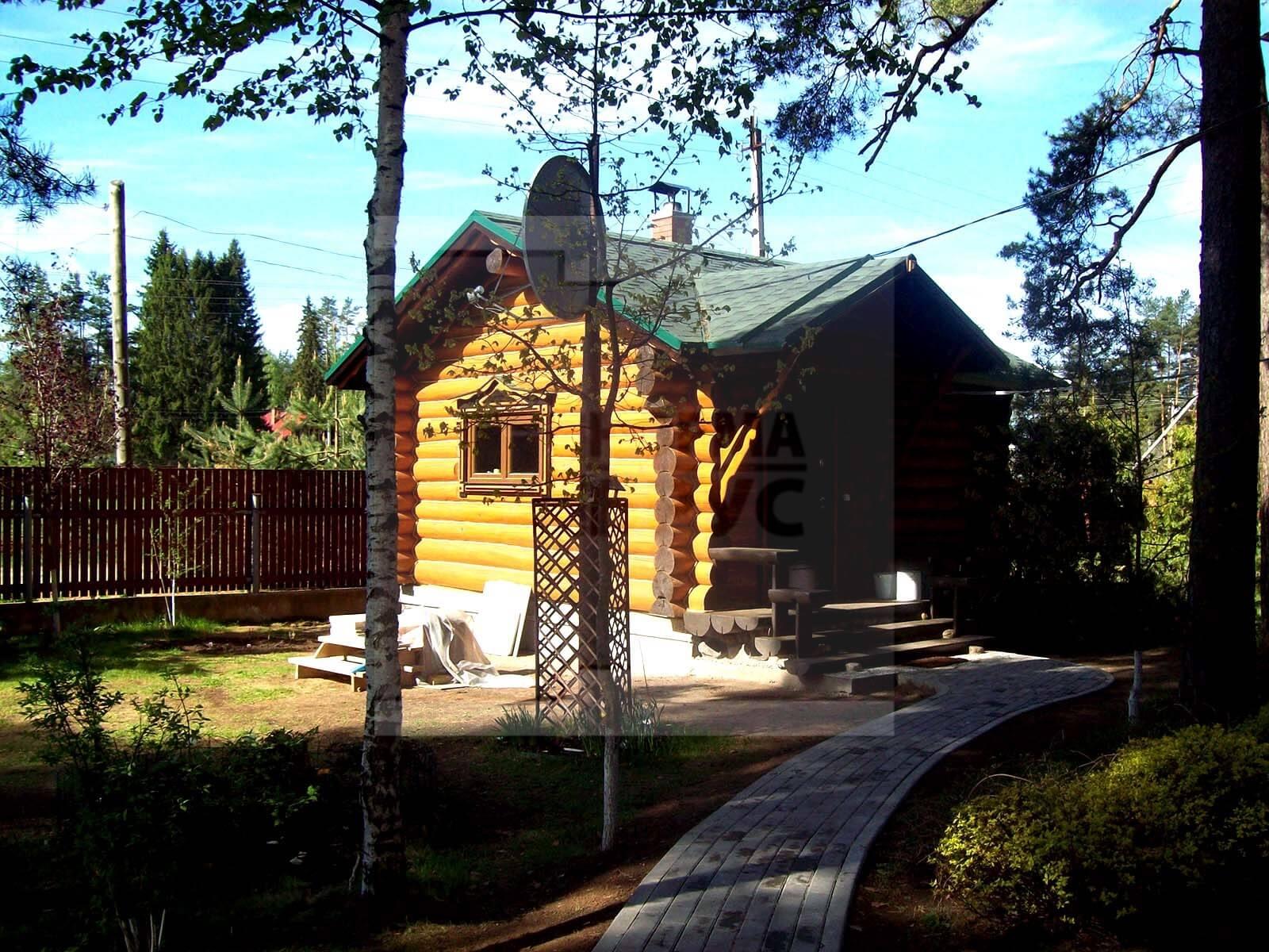 Строительсто дома из бревна ручной рубки